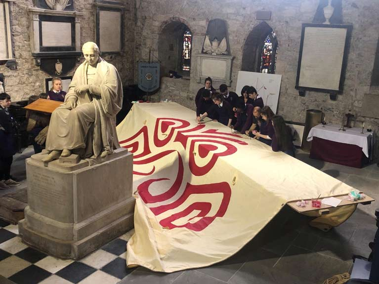 ILENS EDUCATIONAL SALMON SAIL BEING PAINTED BY SCHOOL CHILDREN IN ST.MARYS CATHEDRAL LIMERICK