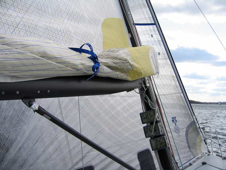 A reefed mainsail tied