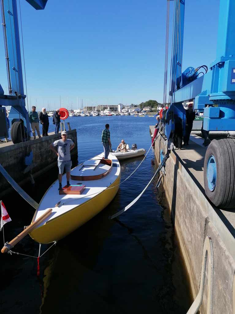 THE SKILLS OF A BOATYARD IN EVIDENCE AS NANEEN IS LOWERED INTO THE WATER AT KILRUSH