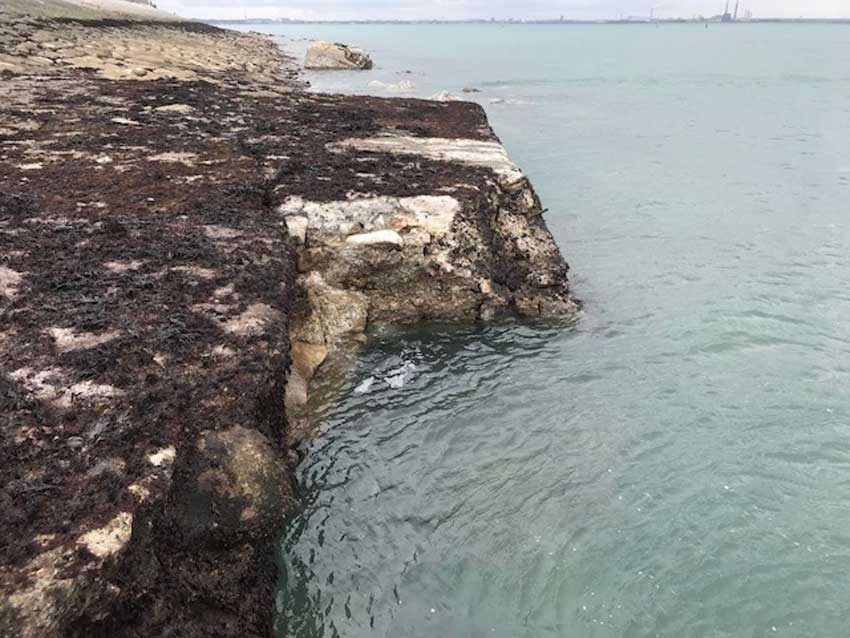 Weathering and erosion of the apron just before the West Pier roundhead