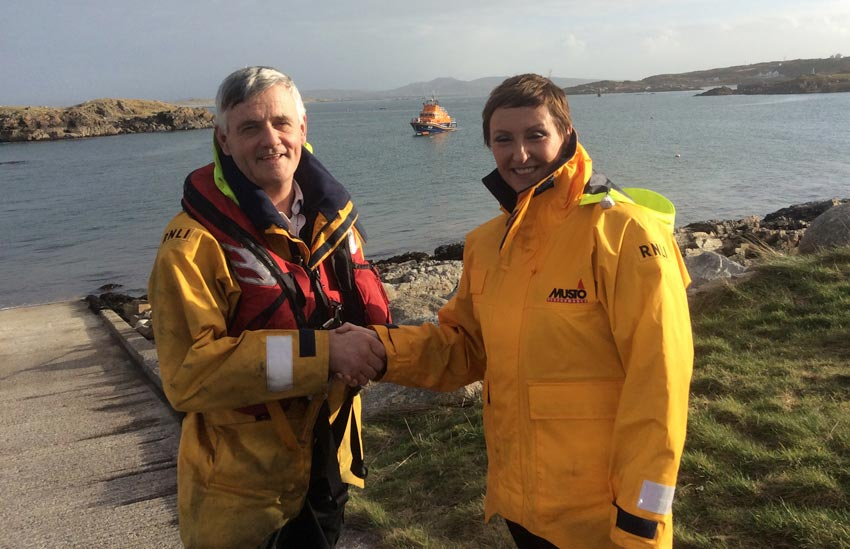 Coxswain Jimmy Early with station president Majella O'Donnell