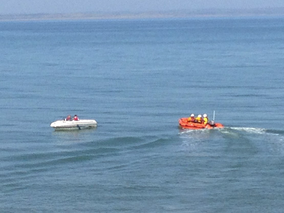 Newcastle RNLI volunteers launching the Inshore Lifeboat