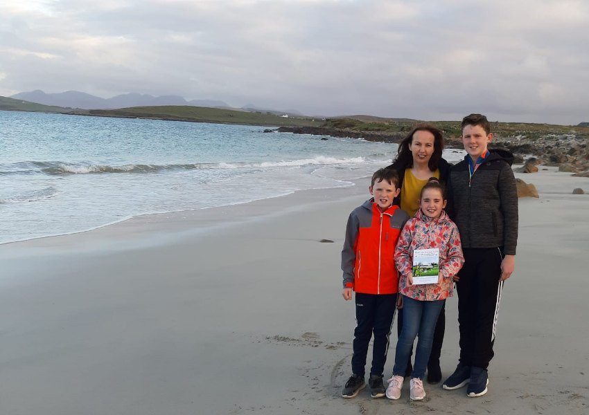 Author Marie Feeney with her children Ronan, Diarmuid and Michaela at Sallerna Beach in Cleggan, Co Galway (Photo: Marie Feeney)