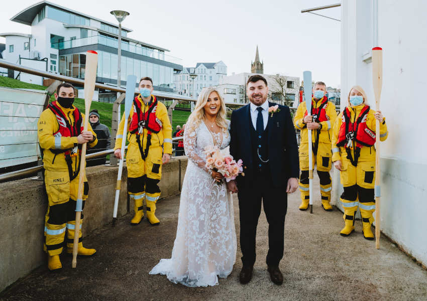 Jason Chambers and his wife Lauren received a special guard of honour from Portrush RNLI after their wedding last week (Photo: Mairéad McDaid/Remain In Light Photography)