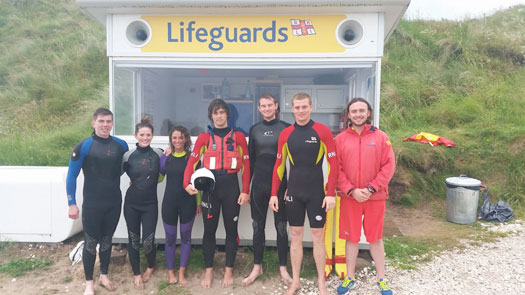 RNLI lifeguards with paddle boarders at Whiterocks