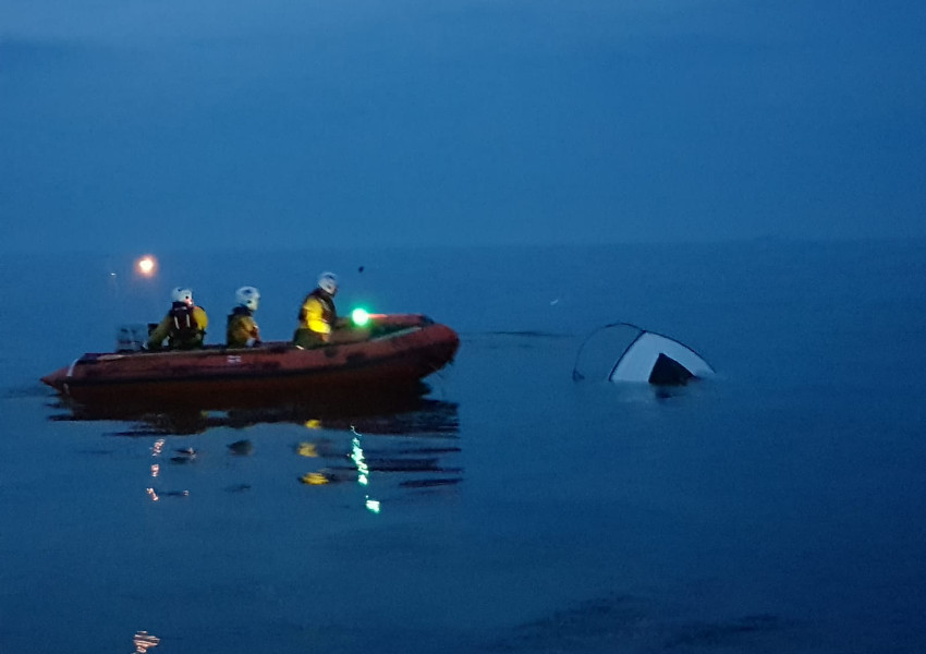 Larne RNLI inspect the submerged vessel | Photo: RNLI/Derek Rea