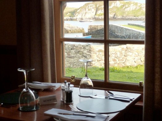 A MacDonald's with a difference – Ainmara serene in the evening sunshine at Poll an Tigh-Mhail, seen from the dining room in the Rodel Hotel. Photo: W M Nixon