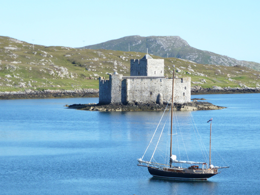 First port in the Outer Hebrides - Castlebay in Barra revelled in the August sunshine Photo: W M Nixon