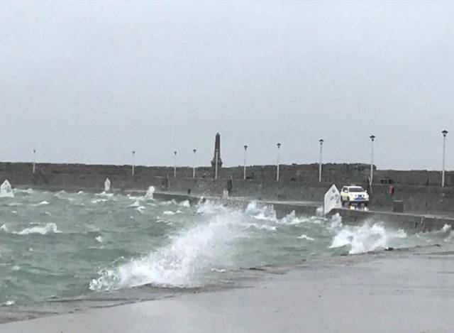 Optimist dinghies in a 45-knot gust end up on the East Pier wall observed by a Dun Laoghaire Harbour Police Patrol
