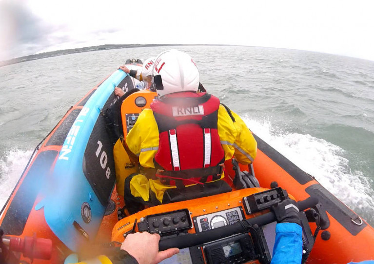 Skerries RNLI returning to station with the paddle boarders on board