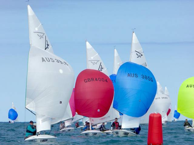 National Yacht Club pair Charles Apthorp and Alan Green (red spinnaker GBR 4004) were second in race four yesterday