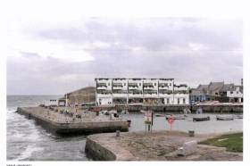 The proposed mixed development in Bulloch Harbour, Dalkey that was refused planning permission in February. DLRCoCo are considering to bring lands at the scenic south Dublin Bay into public ownership.