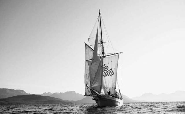 The 56ft 1926-built Ilen setting her full traditional rig off the rugged coast of Greenland