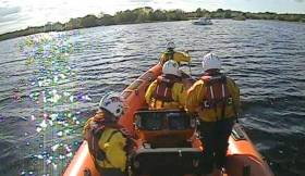The volunteer crew of the Lough Derg lifeboat on route to the motor boat