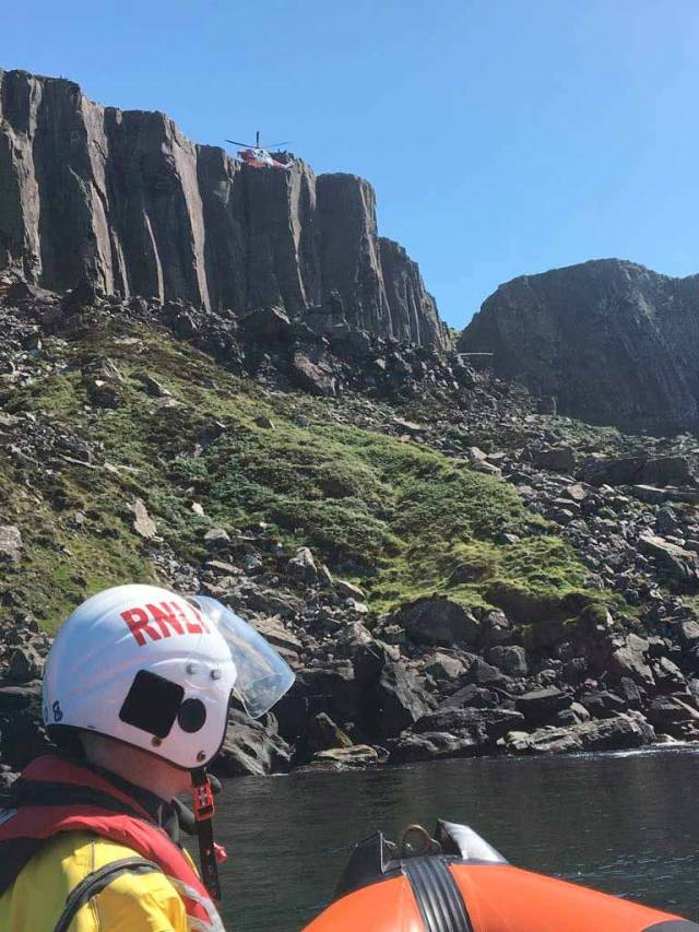 Red Bay's inshore lifeboat attending the scene at Fair Head on the North Antrim coast