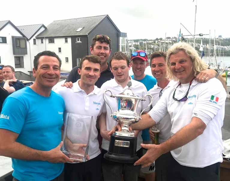 Darren Wright (left) with the crew of Mata and the Irish Half Ton Trophy in Kinsale with co-owners Michael Wright (right) and Rick De Neve (second right)