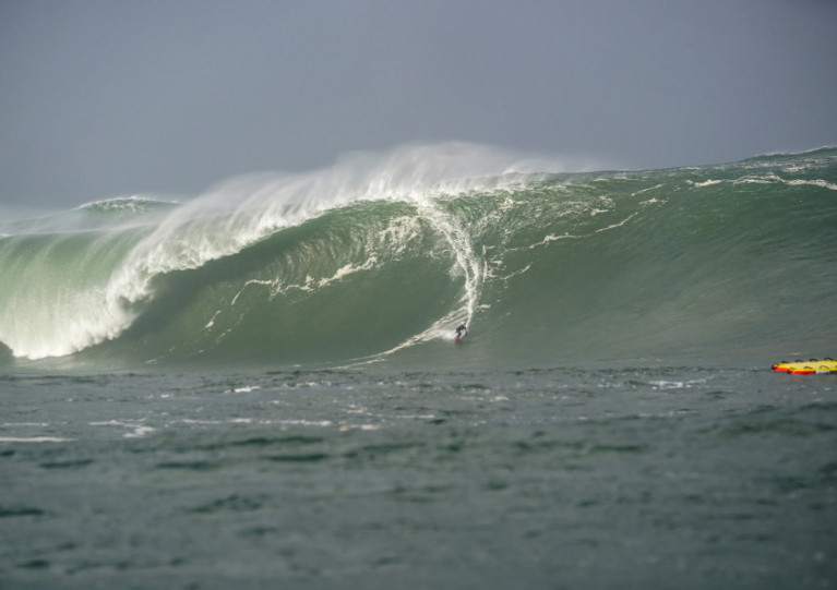 Conor Maguire surfs down a giant wave of Mullaghmore Head in the wake of Hurricane Epsilon