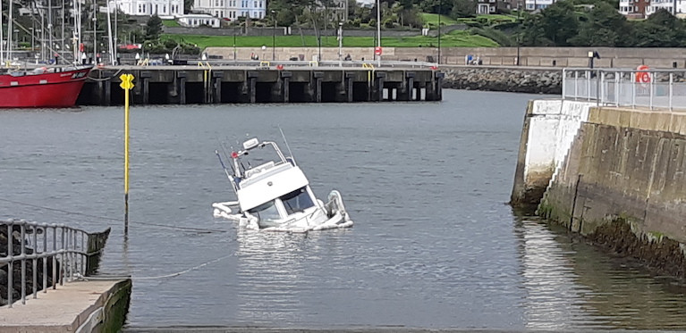 The sunken vessel across the Bangor Harbour slipway