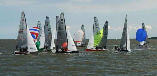 Action at the leeward mark, Shark Eleven leads from Second Wife
