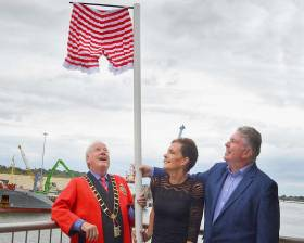 Hoisting the Captains Clam Diggers (From left to right) Frank Godfrey Mayor of Drogheda, Maureen Ward Manager Drogheda Homeless Aid and Paul Fleming CEO Drogheda Port