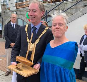 Dun Laoghaire Rathdown Cathaoirleach Shay Brennan presents the 'Spirit of Sailability' trophy to Mary Duffy for her 'determination and sportsmanship competing solo in very challenging conditions'