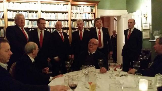 Doyen of the Dublin Judges and George Chapman, Honorary Dublin Judge, serenaded by a barbershop sextet at the 2015 Judges Dinner in RStGyC