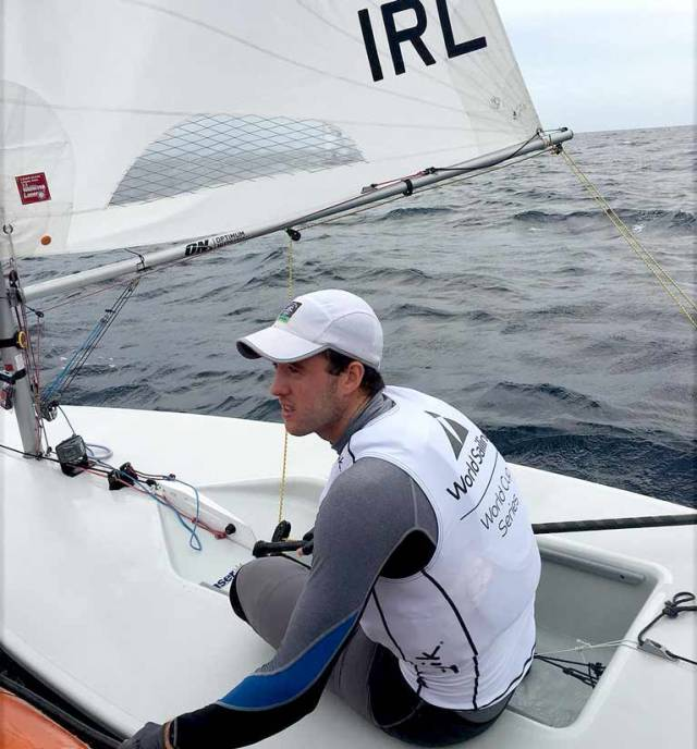 Finn Lynch gets feedback from his coach between races in Enoshima, the Tokyo 2020 Olympic waters