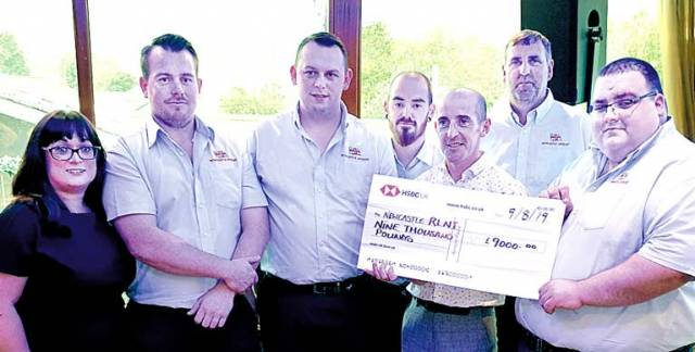 Ruth's fiancé Jim Griffin presents a cheque for £9,000 to Newcastle RNLI's station coxswain Nathan Leneghan (right) and fellow crew members who were involved in the search, from left, Sean Cunningham, station mechanic Shane Rice, Gerry McConkey and David Hughes. Also included is Newcastle RNLI's Lifeboat Operations Manager, Lisa Ramsden.