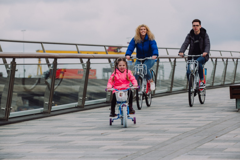 Cyclists take in the Maritime Mile in Belfast Harbour with the backdop of H&W shipyard. Remember to practise social-distancing & stay 2 metres apart from those not in your household.