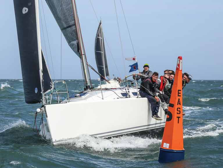 A J109 Class One yacht passes DBSC's East Mark in 2019. A club survey revealed large support for racing on the Bay this season