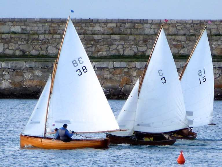 Always in the cut and thrust of it, even after 114 years. Vincent Delany's veteran Water Wag Pansy (no 3) is well able to mix it with much newer boats, and last night (Wednesday) she became the first medal-winner in the National YC's 150th Anniversary Regatta