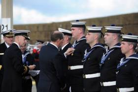 Minister of State with special responsibility for Defence Paul Kehoe presenting the new international operational service medals to Irish Navy Service personnel