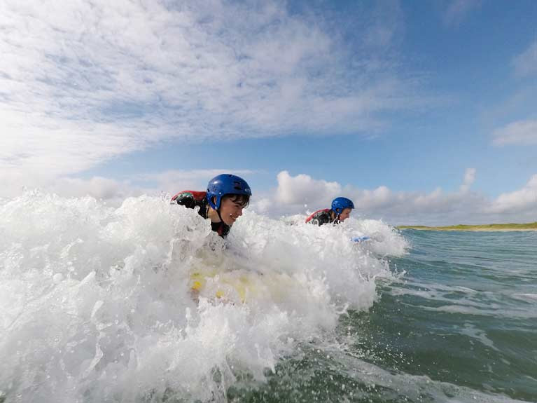Surfing at Colaiste Uisce in County Mayo