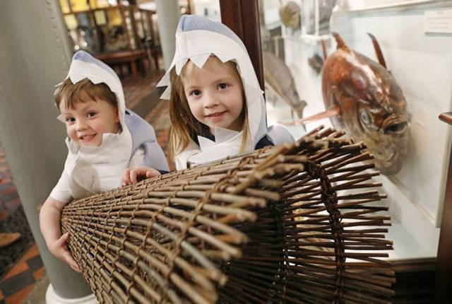 Rory Cahill (4) and Evelyn Cahill (6) from Dunboyne, Co Meath with a replica of a Mesolithic fish trap at the launch of Fishy Fun at the National Museum of Ireland - Natural History
