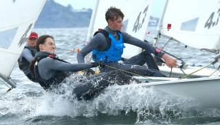 Laser sailors round a mark at the National Championships on Belfast Lough