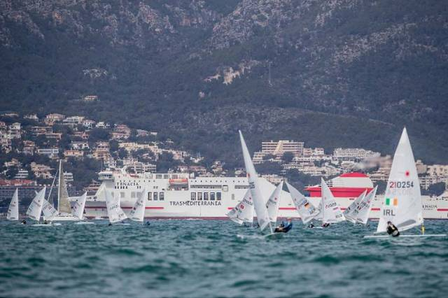 Finn Lynch (right of shot) makes his approach to the weather mark and a fine seventh placing in the first race of Trofeo Princesa Sofia Regatta in Mallorca