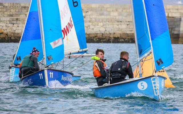 Defending champions Micheál O' Sullivan and Mikey Carroll lead a race at the 2018 All Ireland Junior sailing championships raced inside Dun Laoghaire Harbour