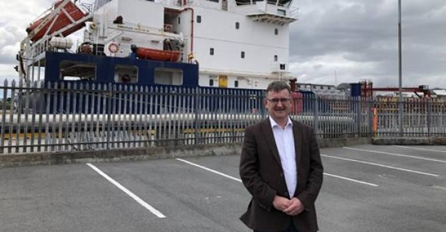 Port of Galway CEO Conor O'Dowd in front of a regular visitor to the city's Docks, the Corrib Fisher. AFLOAT adds the James Fisher Everard tanker operates from Whitegate Oil Refinery, Cork Harbour which was previously served by Galway Fisher.