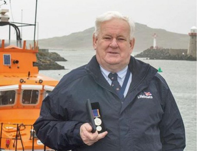 John McKenna with his RNLI long service medal