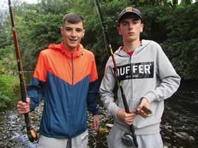 Nicky O'Hagan and Matthew McDonald of Whitechurch Youth Group enjoying the fishing in Milltown