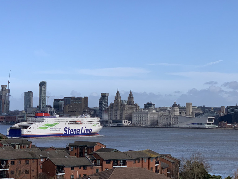 The newest ferry on the Irish Sea AFLOAT adds is the Stena Edda which recently made its maiden voyage from Birkenhead on the Wirral (as above) to Belfast. The E-Flexer class ferry faces opposite of Liverpool, when swinging off the newly upgraded Twelve Quays Ferry Terminal on Merseyside. Afloat also adds on the right is the Museum of Liverpool.