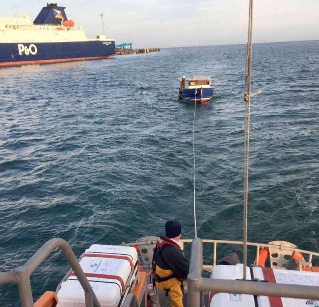 The all-weather lifeboat Dr John McSparran tows the stricken motorboat to Larne Harbour