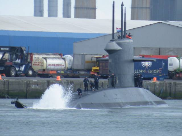 "The distinctive ""X"" tail stern configuration of Dutch submarine HNLMS Walrus with wash generated when swinging off Ocean Pier in Alexandra Basin in Dublin Port. At this same pier is where currently a sister, HNLMS Zeeleeuw is docked alongside support ship HNLMS Mercuur."