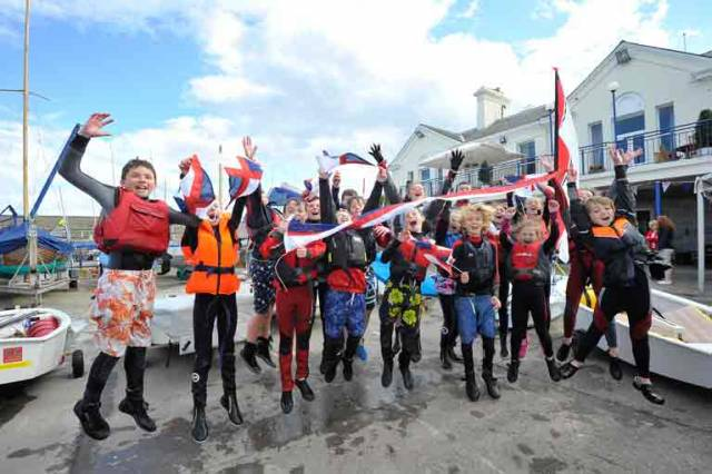 The Juniors of the National Yacht Club celebrate Annalise Murphy's Olympic achievements. When the Junior Training programe at the National YC was inaugurated 50 years ago, the extensive boat platform on which this is all happening didn't exist