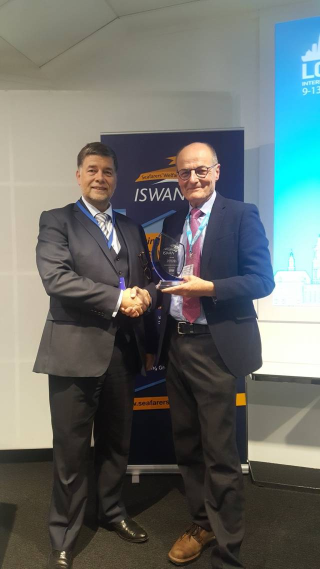 Ronald Spithout President of Inmarsat presents ISWAN award to Liverpool Seafarer Centre CEO John Wilson during LISW2019