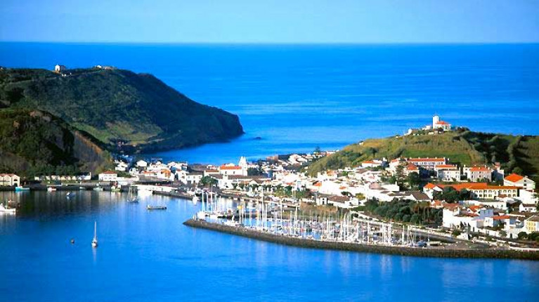 Popular Transatlantic port-of-call. Horta with its friendly harbour on Faial in the Azores makes for a handy destination for cruisers crossing the Atlantic. Beyond that sheltering neck of land, it's clear water all the way to the Caribbean