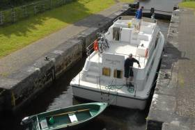 A boat traverses a lock on the Shannon-Erne Waterway