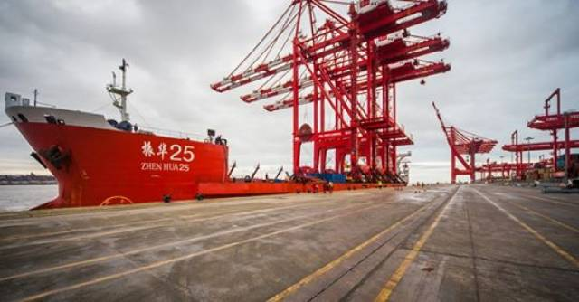 New cranes totaling three built in China onboard a heavy-lift vessel alongside the Liverpool2 container terminal
