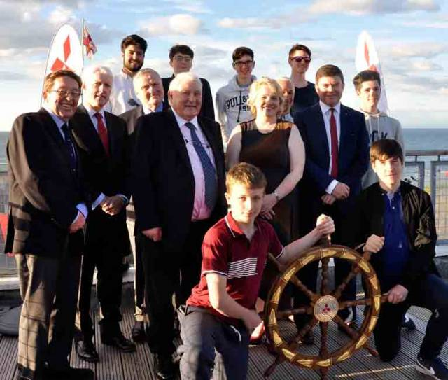 "Spanning the generations. At the award of the Mitsubishi Motors ""Sailing Club of the Year 2017"" trophy to Wicklow Sailing Club were (back row, left to right) Cillian Ballesty, Robert Bell King, Carl Somers, Kieran Fitzgerald and Ryan Fitzgerald, (middle row) W M Nixon, Billy Riordan (CEO Frank Keane Holdings), Jack Roy (President Irish Sailing Association), Frank Keane (Chairman FKH, owners of Mitsubishi Motors Ireland), Denise Cummins (Commodore, Wicklow SC (2017-2018), Hal Fitzgerald (Commodore WSC 2015-2016), and Gerard Rice (MD, Mitsubishi Motors) (front row) Jack Cummins and Hal Og Fitzgerald. Photo: Angela Ballesty"