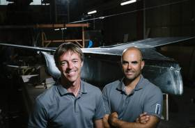 Niels Frei and Yves Detrey with the hull of their prototype NTFM Syra 18 foiling dinghy